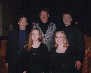 "Some of Camerata's earliest members: (back row, l. to r.) Andrew Balfour, Michael Thompson, Kenton McPeek; (front row, l. to r.) Jennifer (Whicker) Engbrecht and Sheri Lohrenz, in their ""home"" church of St. Margaret's, in 1997."