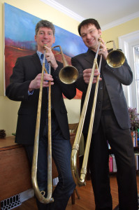 Conductor Ross Brownlee (left) and guest musician Steven Dyer pose with their sackbuts in a promotional shot for The Full Monte, 2013. (Photo: Karine Beaudette)