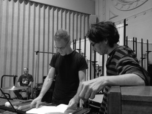 Ed Reifel, of Correction Line Ensemble, and Andrew Balfour during rehearsal, with another collaborator, Gérald Laroche, in the background, 2013.